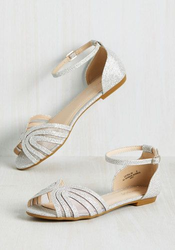 Betting on clear skies, you don these metallic flats, and, wouldn't ya know it - here comes the sun! A walk in these twinkling peep toes is always a picturesque one, especially when you catch sight of this pair's matching mesh inserts and classic buckles. Definitely a winner!
