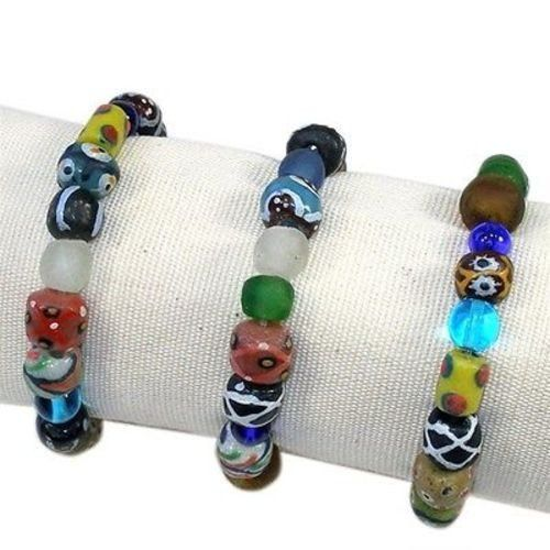 Hand Painted Glass Bead Bracelet - Kenya. Hand Painted glass beads from Ghana make up this accent piece that brings funky youth and eclectic style together. Bead jewelry boho bohemian designs | Unique vintage tribal rustic crafts | African simple inspiration gifts for her girlfriends mom mother sisters kids daughters | Trendy beadwork jewellery products store shop website