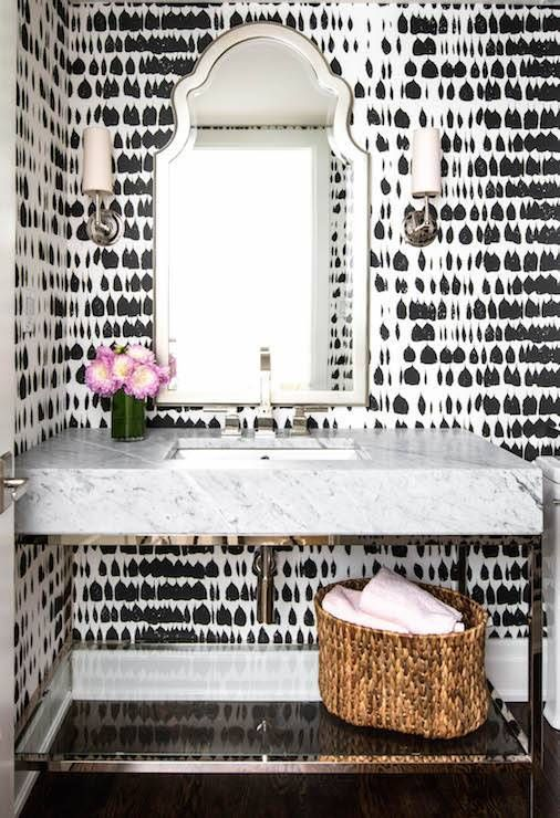 Glam Powder Room With Printed Black And White Wallpaper A Silver Mirror And Flowers
