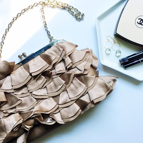 ✨HP✨Boutique Beige Silk Ruffle Purse This sweet ruffle purse is perfect for any formal occasion. Optional chain can be tucked inside to turn into a simple clutch. In perfect condition. 🎉Host Pick: Girly Girl🎉 Boutique Bags Mini Bags