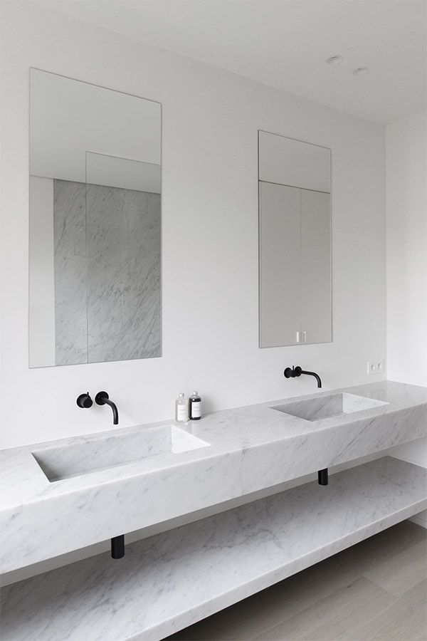 Bath with Black Faucets by Rolie + Dubois | Remodelista
