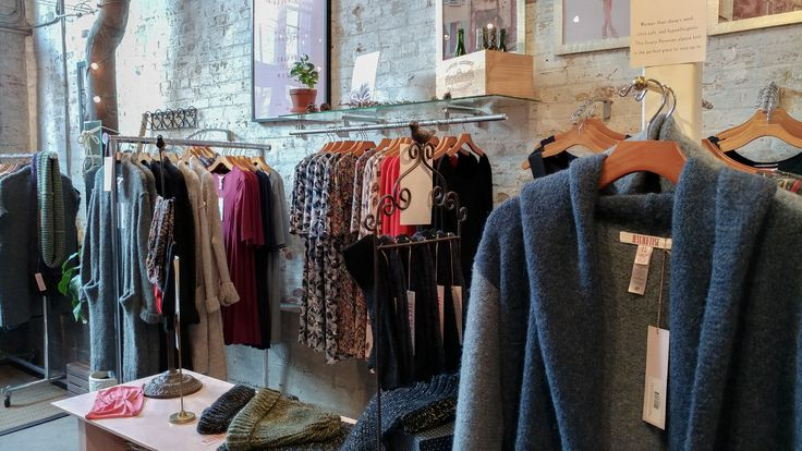 A view from inside our store in the Historic Distillery District, downtown Toronto, Canada. Cozy knitted alpaca sweaters and cardigans, Liberty of London printed dresses, little black dresses and classic designs that never go out of style! Why wouldn't you want to be wearing super comfortable clothes while showing off your fresh Parisian fashion style! #fashion #womensfashion #womenswear #parisstyle #frenchstyle #designerclothing #designer #design #cozyspaces