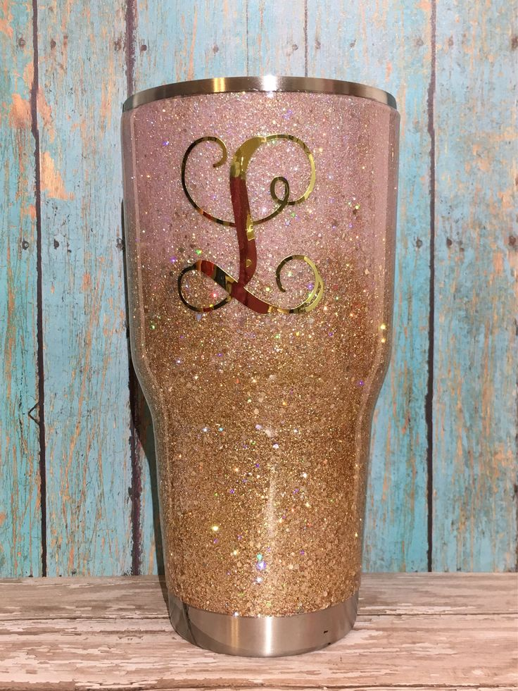 Pink and Champagne Gold Ombre Glitter Tumbler - Yeti, Rtic, or Ozark - 30 oz. or 20 oz. Light pink, slightly holographic glitter is paired with a mixed size, champagne gold, holographic glitter. Tumbler is double dipped in SOLID GLITTER for the maximum sparkle! Glitter and optional decal(s) are sealed with a smooth, clear gloss that is waterproof and FDA approved food-grade. A small ledge is left free of glitter for those who prefer to drink directly from the cup. Lid is included. To add a…