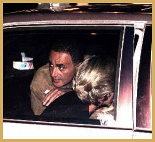 Dodi Al Fayed looks over Princess Diana's shoulder as the Mercedes is pulling away from The Ritz hotel in Paris on August 31, 1997.  Minutes later, as we all know....is history.