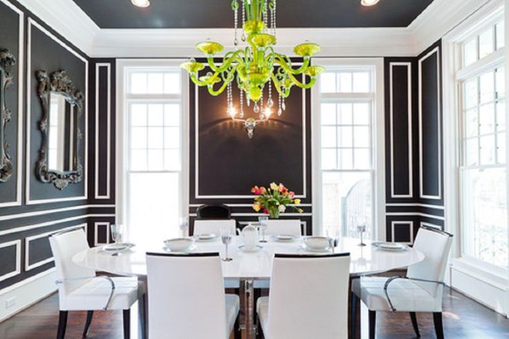 Dining Room, Mesmerizing Dining Room Ideas For Apartments With Rounded White Table And White Chair Covers Also Charming Chandelier Along With Black And White Wall Décor: Creating Limited Space with Special Dining Room Ideas for Apartments