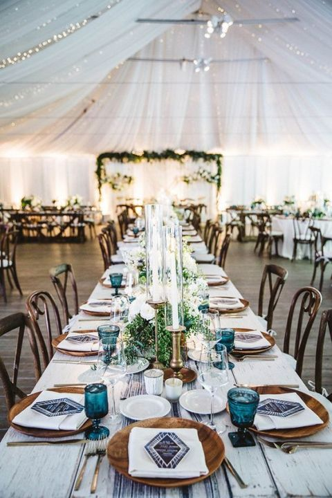 For this white-themed wedding, blue shibori runners and geodes were used to add a pop of color and reflect the couple's bohemian personality. Via 100 Layer Cake.