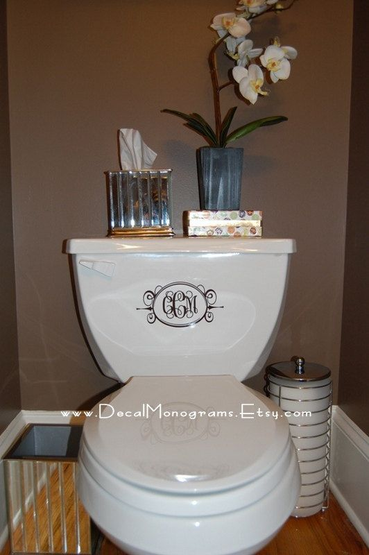 What a great idea! I'll have to use my silhouette to create a monogram to fancy up the toilet.