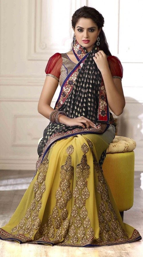 Lovely black and yellow chiffon half and half saree which is adorned with stone, zari embroidery work on the first half in the vertical panel, paisley pattern work on the pallu and cord work on the side parts. Contrast blouse piece attached with this attire. The blouse of this saree can be stitched in the maximum bust size of 40 inches.