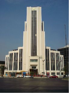 The art deco building above differs from the rest of the buildings as it has a flat roof and is smaller however there is still sequential features visible. The symmetrical balance of the building is the key feature that makes it belong within the era as many sky scrapers tended to have powerful symmetry as a way of representing their power and superiority.