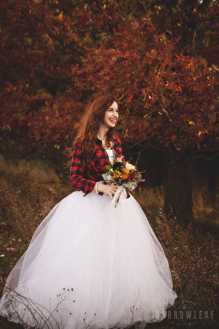 Adventure styled bride with tutu wedding dress and plaid flannel shirt.