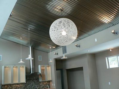 A corrugated metal ceiling..the same material used for roofing.Very inexpensive