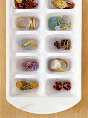 Ice cube tray being used to hold jewelry.  Idea originally from Real Simple Magazine via Armelle blog