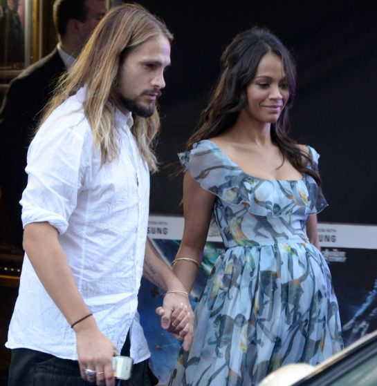 """Pregnant Zoe Saldana and husband Marco Perego leave the """"Guardians of the Galaxy"""" premiere in London"""
