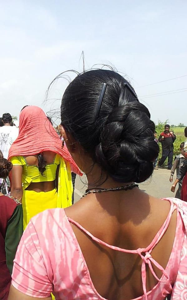 Great and lovely bun.   Beauty is at every age, and we can embrace God's gifts. A wife's long hair is just naturally beautiful, a glory to her and a joy to her partner/husband. Quit trying the artificial route and trust in how you were made.