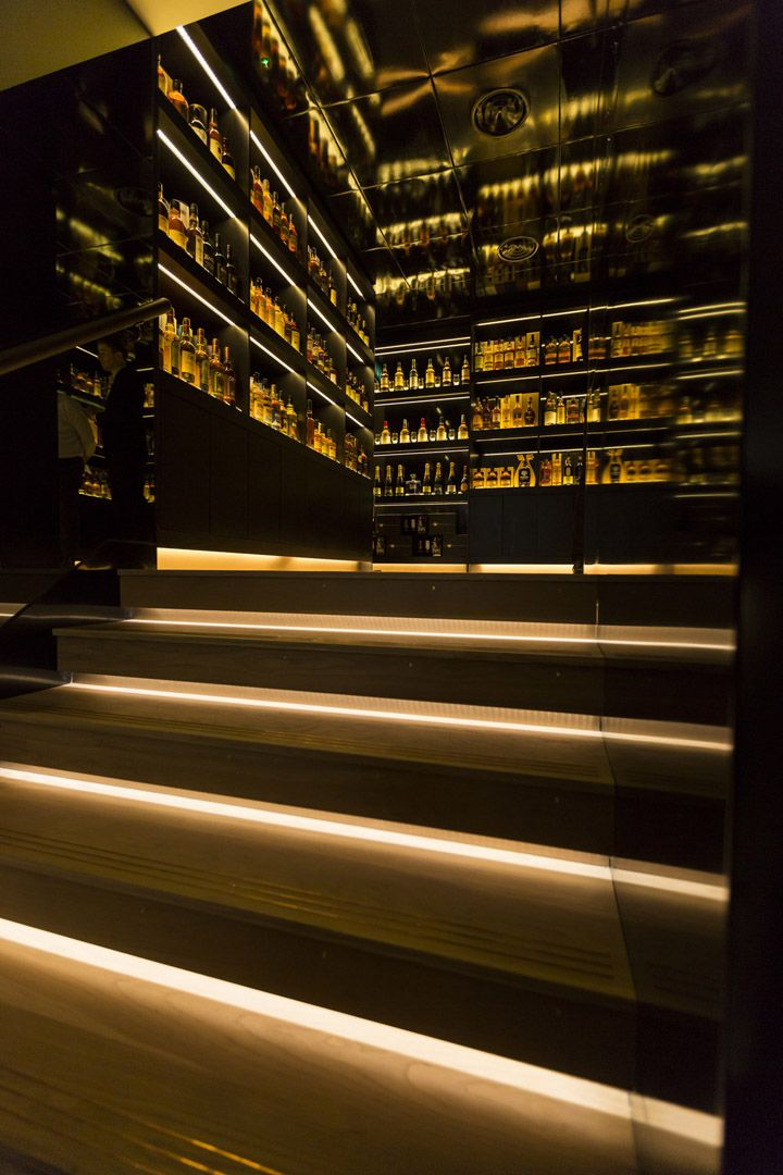 """A glass gantry with black UV-bonded glass links the front retail space with the """"sell me"""" room, The Whisky Shop Library. Here, customers can choose from a vast selection of rare and exclusive whiskies."""