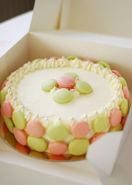 French macaroons surrounding a cake. Can it get better than this?