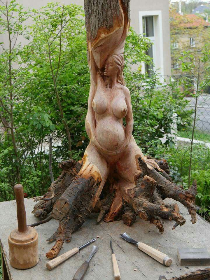 Beauty at its finest...the motherly form rising from the tree...gorgeous
