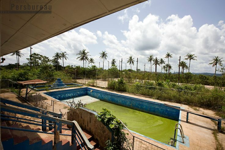 Swimmingpool at the abbandoned clubhouse, the building is empty since the miningcompany left Dunkwa. Ghana.