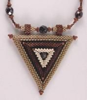 Sculpt this striking three-dimensional pendant with high-precision Aiko Japanese cylinder beads.   A crystal is trapped in the center, and raised bands add interest and depth.   Finish as shown with Peyote beaded beads, or design your own cord.   You should be experienced in Peyote stitch