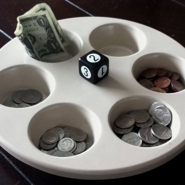 A fun game to teach COIN VALUES. Simply roll the dice (once per turn) and take that number of pennies. As often as possible exchange 5 pennies for 1 nickel, 2 nickels for 1 dime, 2 dimes and 1 nickel for 1 qtr., and 4 qtrs. for the $1 bill. The first one to $1 wins the game. Perfect for some Kinders and most 1st graders.