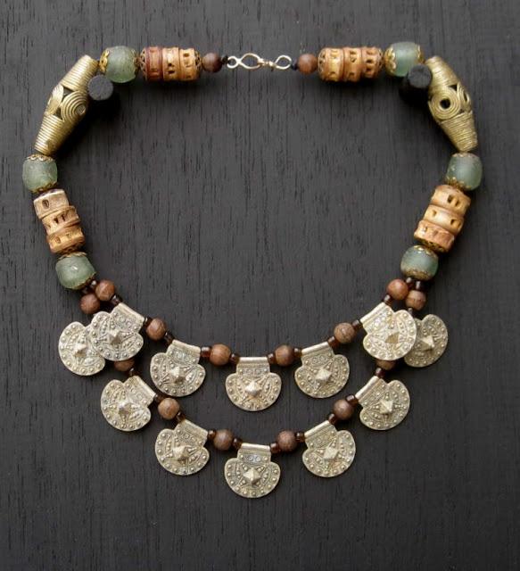 Necklace | Saada Designs.  West African bronze, metal  and glass beads, henna coloured fish bones, wood