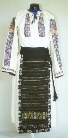 Romanian Women's costume from county of Bistriţa-Năsăud Gathered neck linen chemise (cămaşă încreţită), decorated with purple and black embroidered motifs making a rectangular strip across the top of the shoulder (altiţă), with a narrow yellow strip below this (încreţ), and vertical stripes (râuri) on the front, and sleeves. The sleeves also have vertical lines of isolated motifs and a row of these motifs round the lower ends, which are also edged with black crochet lace.