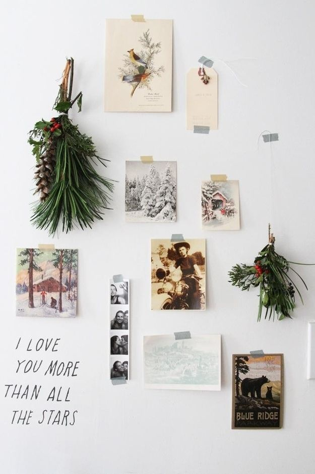 Display your holiday cards on the wall along with pops of greenery. | 21 Ways To Decorate A Small Space For The Holidays:
