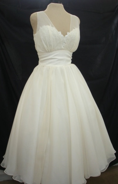 I love the idea of a cocktail length wedding dress
