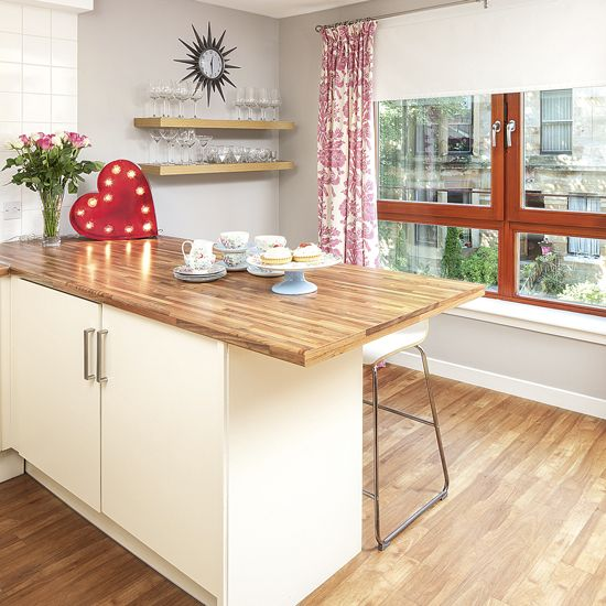 Kitchen breakfast bar with wooden worktop and floor