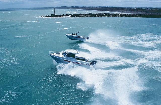 AMF 660 and 580 crossing Wanganui Bar by AMF Boats, via Flickr