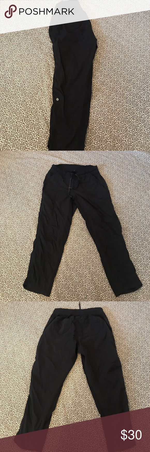 Lululemon unlined pants Size 12 size dot confirmed navy Lululemon unlined pants.  These remind me of studio pants but the logo is on the calf.  Drawstring for a comfortable fit and multiple pockets. lululemon athletica Pants Track Pants & Joggers