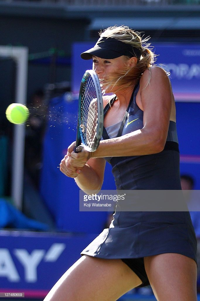 Maria Sharapova of Russia plays a backhand in her match against Julia…