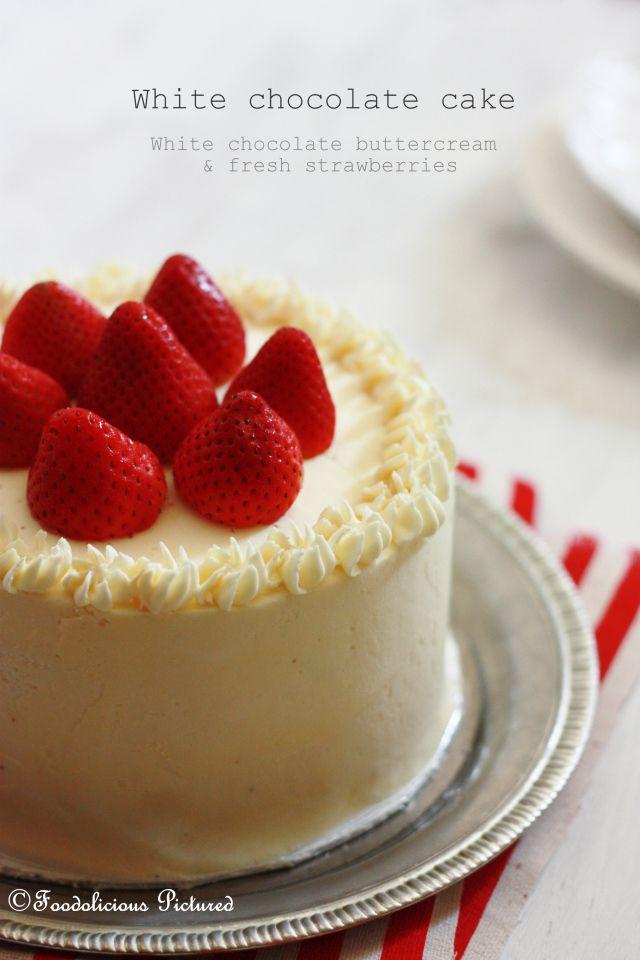 white chocolate cake with white chocolate buttercream and fresh strawberries