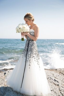 Black and White Strapless Wedding Gown   Article: Unique Wedding Dresses for the Trend-Setting Bride   Photography: Carrie Rodman Photography   Read More:  http://www.insideweddings.com/news/fashion/unique-wedding-dresses-for-the-trend-setting-bride/2491/