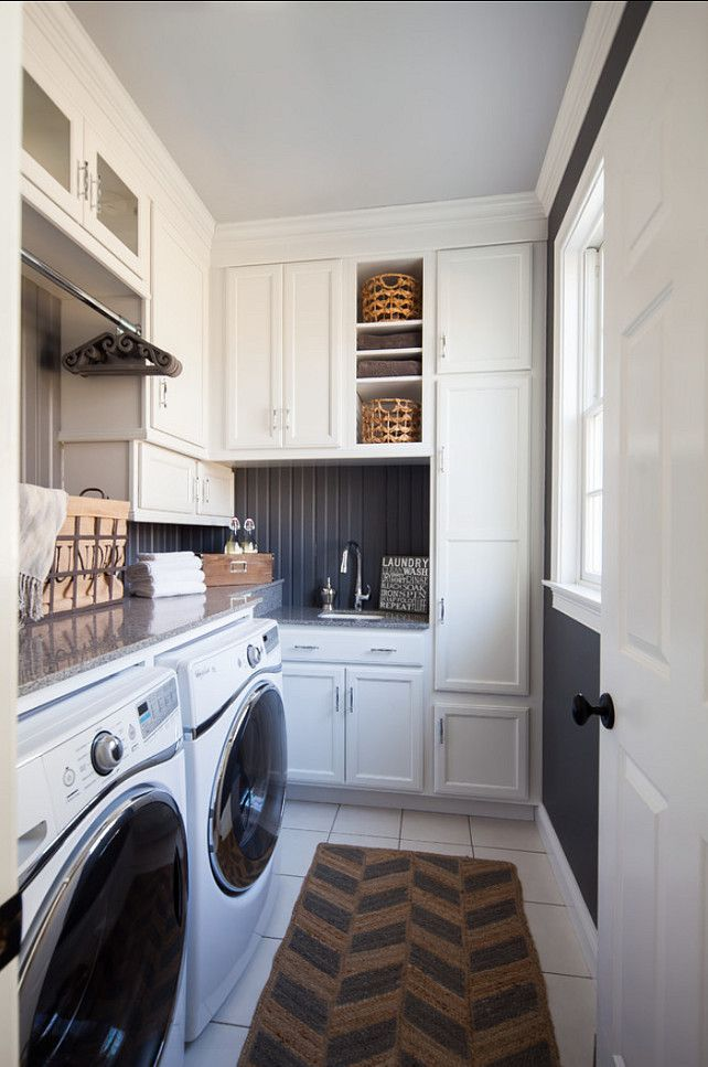 white cabinets, off-black walls.  Laundry Room Design. Small Laundry Room Design. #LaundryRoom #SmallSpaces