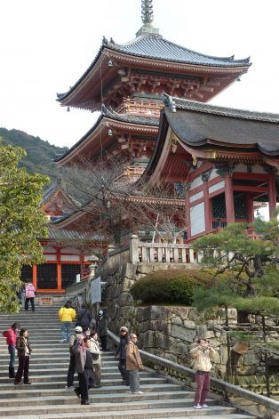 Visitors are dwarfed by the three-story pagoda at the popular Kiyomizu-dera Buddhist temple in Kyoto. Photo: Spud Hilton, The Chronicle