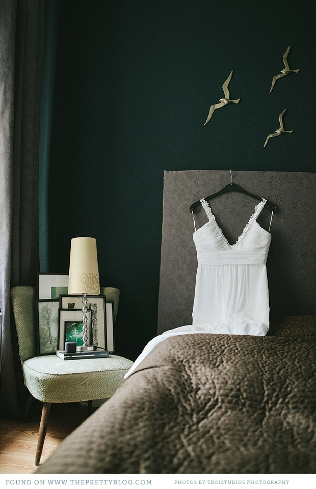 i really love this dark green, grey, gold bedroom.