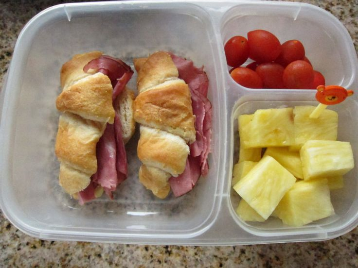 Croissant sandwiches, fresh fruit and veggies.