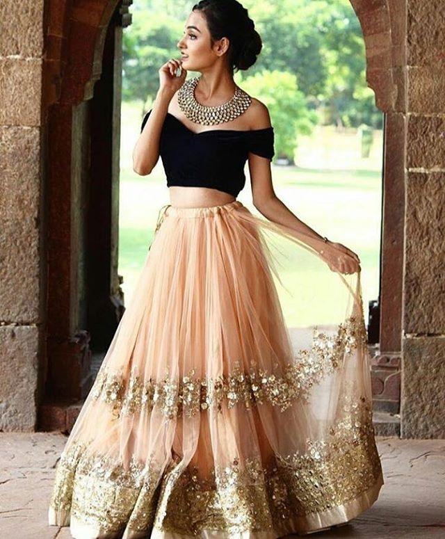 Image result for off-shoulder blouse opaired with a cummerbund and lehenga