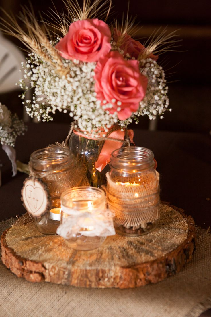 Florals by Rhonda llc Lohmeier Photography Vintage, romantic, burlap & lace Aisle and Table Centerpiece of wheat stalk, coral roses and gypsophilia.