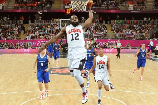 James Harden #12 of the USA Men's Senior National team goes for a dunk against France at the Olympic Park Basketball Arena during the London Olympic Games on July 29, 2012 in London, England. At the game, British fans received a tutorial in basic basketball
