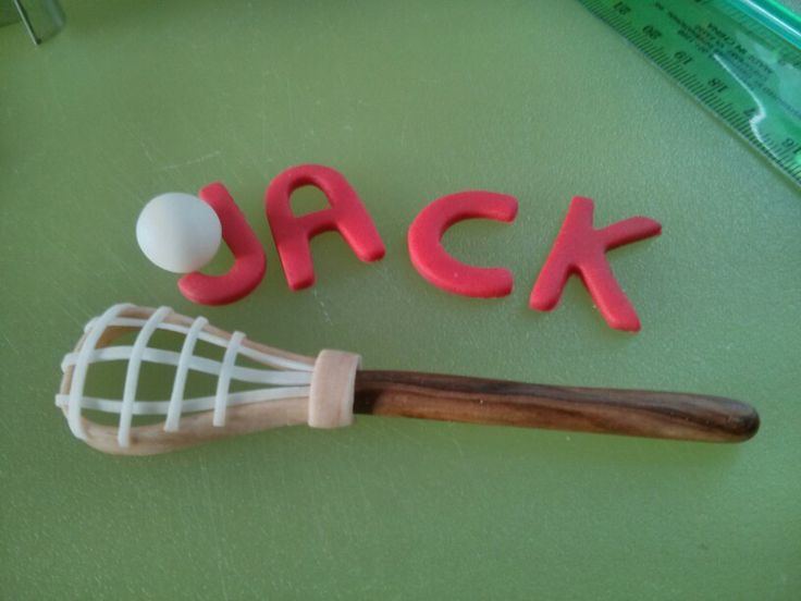 Lacrosse cupcake topper...out of fondant...;)