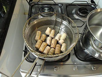 How to work with corks without them crumbling if you plan to cut them down... boil in water for 10 mins and then the cork won't crumble