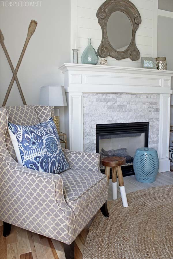 Marble stone fire place, white mantle, wood board up wall