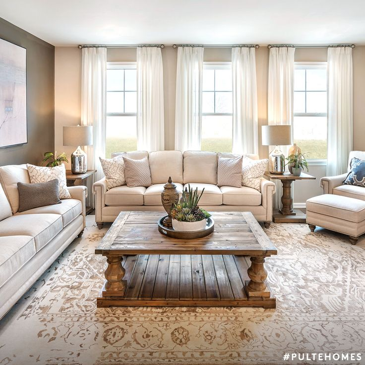 Keep it simple with an inviting, neutral living room that will transition perfectly from summer to fall. | Pulte Homes