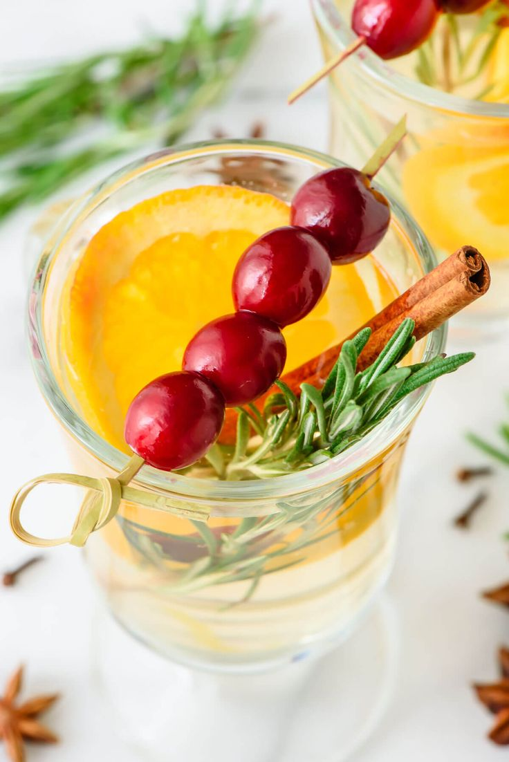 Best Ever Slow Cooker White Spiced Wine with cinnamon, orange, and cranberry. An easy, cheap, and festive holiday drink that is perfect for parties!