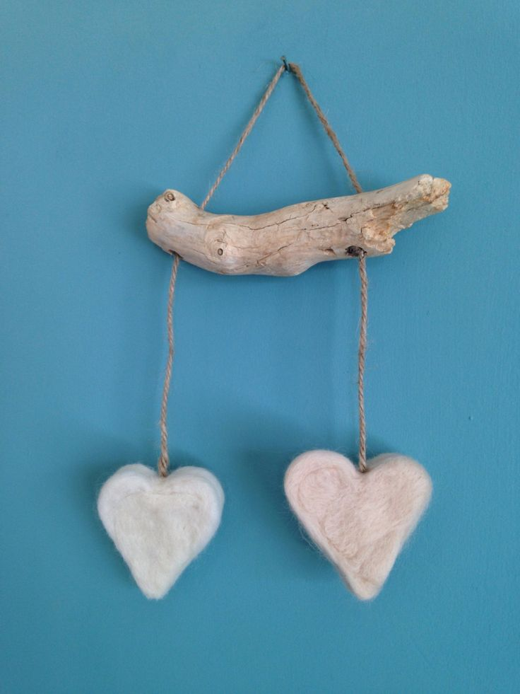A personal favourite from my Etsy shop https://www.etsy.com/uk/listing/471499971/rustic-driftwood-and-hearts-wedding