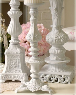 White candle holders - they look like painted lamp bases. Good to keep in mind when you're at an auction or yard sale.