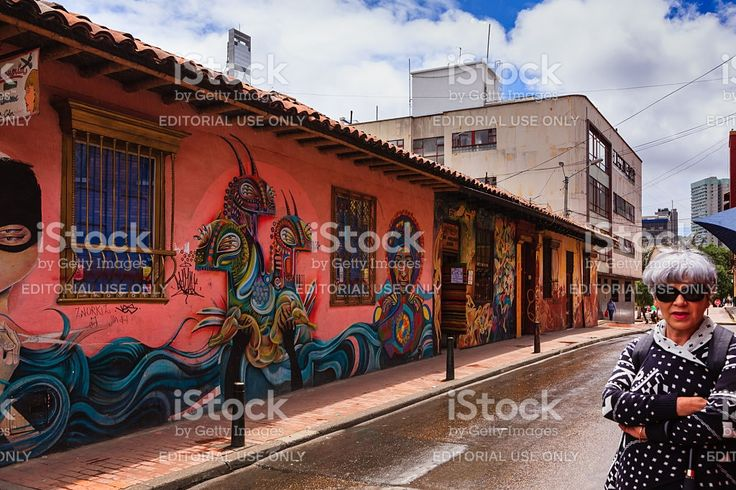 Bogota, Colombia - Lady and Street Art in La Candelaria royalty-free stock photo