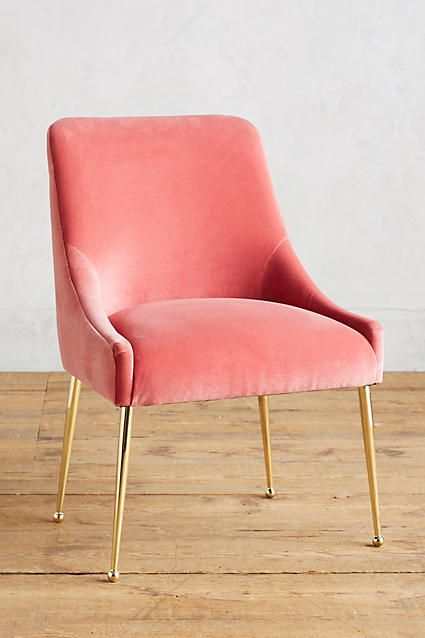 Pink velvet chair with gold hardware. Pink and gold chair.
